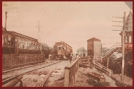 "(Courtesy Madison County Historical Society) Rotogravure of ""Third Rail Cars of the Oneida Railway Co, Oneida Castle Station"" (a. 1907). The station, built in 1883, can be seen to the right, Passengers from Utica and Syracuse would disembark from the electrified interurban trains, descend to the lower level and catch a local Ontario & Western train going north to Sylvan Beach."