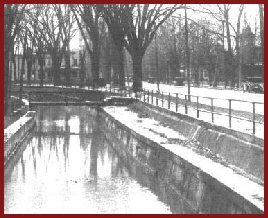 The old Erie Canal feeder along Main Street, Oneida, looking south from Washington Avenue (c.1925)